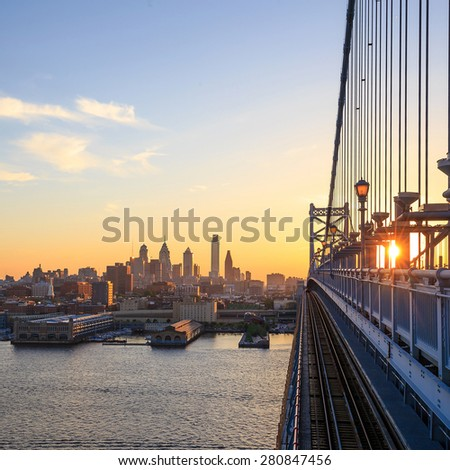 Panorama of Philadelphia skyline, Ben Franklin Bridge and Penn's Landing sunset  - stock photo
