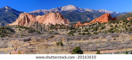Panorama of Pikes Peak Soaring over the Garden of the Gods near Colorado Springs, Colorado - stock photo