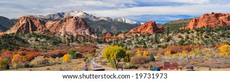 Panorama of Pikes Peak Soaring over the Garden of the Gods near Colorado Springs, Colorado in Autumn - stock photo