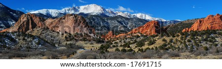 Panorama of Pikes Peak Soaring over the Garden of the Gods near Colorado Springs, Colorado in Winter - stock photo