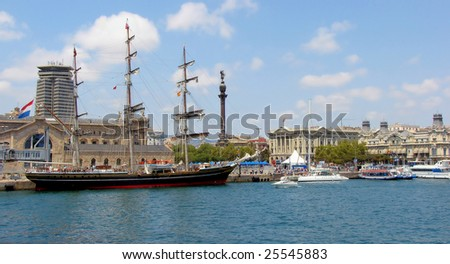 panorama of port and quay of barcelona with  sailing ship - stock photo