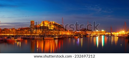 Panorama of port with yachts against Castle of Santa Barbara in night. Alicante, Spain - stock photo