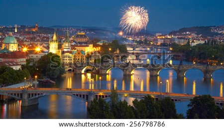 Panorama of Prague after sunset with fireworks - stock photo