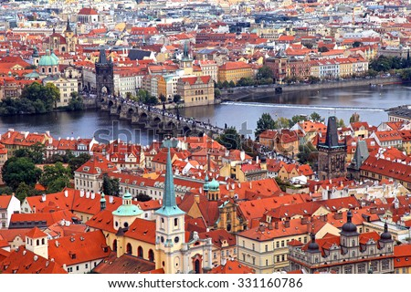 Panorama of Prague Old Town with red roofs , famous Charles bridge and Vltava river, Czech Republic. View from above - stock photo