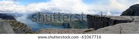 panorama of preikestolen cliff in norway with the fjord and steep rocks - stock photo