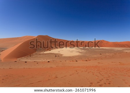 Panorama of red dunes from Hidden Vlei, Sossusvlei Namibia - stock photo