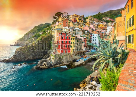 Panorama of Riomaggiore and wonderful sunset,Cinque Terre National Park,Liguria,Italy,Europe - stock photo