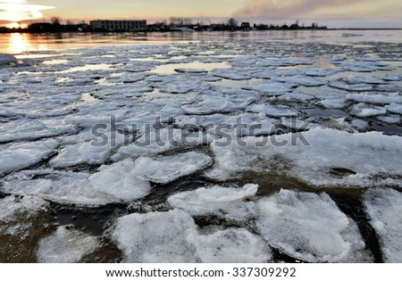 Panorama of river valley with spring ice drifting at sunset - stock photo