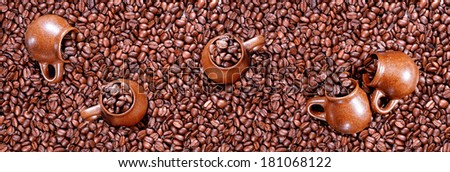 Panorama of roasted coffee beans and cups. - stock photo