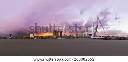 Panorama of Rotterdam's Skyline with Erasmus Bridge at Sunset, The Netherlands - stock photo