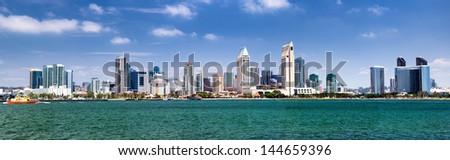 Panorama of San Diego - California downtown with it's hotels and office buildings. Photo taken from Coronado Island. Beautiful summer day. - stock photo