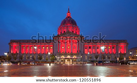 Panorama of San Francisco City Hall illuminated by red light to honor World AIDS day. - stock photo