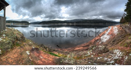 Panorama of Schluchsee Lake in The Black Forest, baden Wurttemberg, Germany on a cold, autumn day. - stock photo