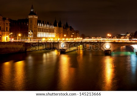 Panorama of Seine with pont au change in Paris at night