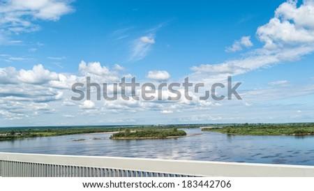 Panorama of Severnaya Dvina River with island under blue sky. Kotlas, Arkhangelsky region, Russia.  - stock photo