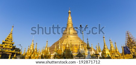 Panorama of Shwedagon pagoda with blue sky. Yangon. Myanmar or Burma. - stock photo