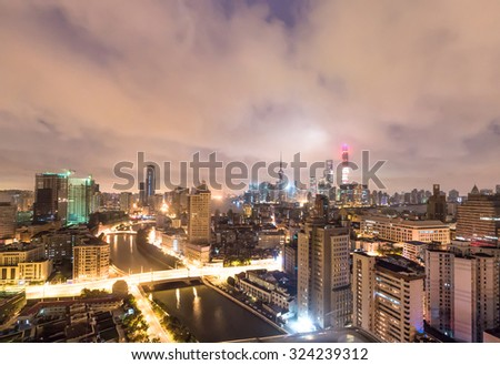 panorama of skyscrapers with overlooking perspective  in a modern city at night