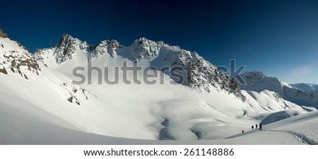 Panorama of snow-covered glacier and mountain peaks of Kyrgyzstan. Kyrgyz Range - stock photo