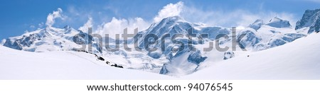 Panorama of Snow Mountain Range Landscape with Blue Sky at Matterhorn Peak Alps Region Switzerland - stock photo