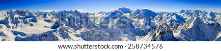 Panorama of Snow Mountain Range Landscape with Blue Sky at Mt Fort Peak Alps Region Switzerland - stock photo