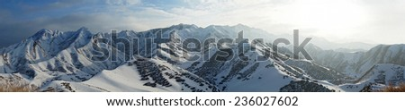 Panorama of Snow Mountain Range Landscape with Blue Sky at xin jiang Region China - stock photo