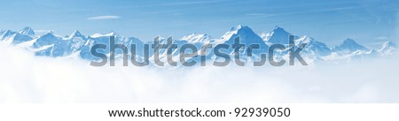 Panorama of Snow Mountain Range Landscape with Blue Sky from Pilatus Peaks Alps Lucern Switzerland - stock photo