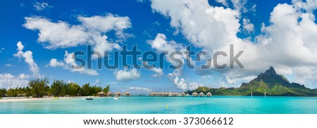 Panorama of stunning beach and beautiful view of Otemanu mountain on Bora Bora island - stock photo