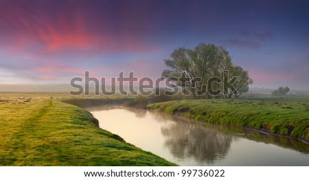 Panorama of summer sunrise on the river. - stock photo