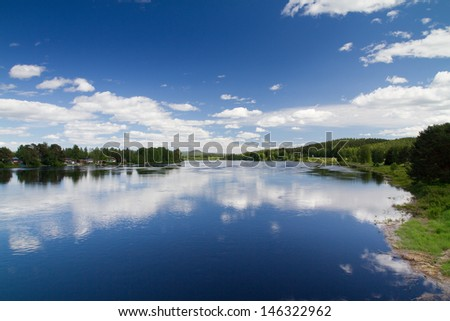 Panorama of Swedish lake in the summer time - stock photo
