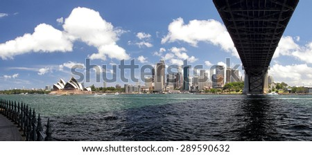 Panorama of Sydney Cove and the Harbour of Sydney, Australia, view on the Skyline of Sydney and the Sydney Opera House. Seen from below Sydney Harbour Bridge. - stock photo
