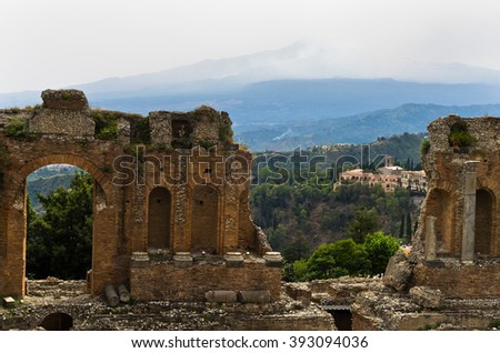 Panorama of Taromina from ancient greek theater, mount Etna in background, Sicily, Italy - stock photo