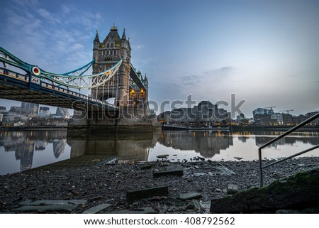 Panorama of Thames river Tower Bridge during low tide in London, England
