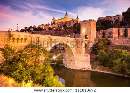 Panorama of the alcazar above the medieval San Martin bridge - Toledo, Spain - stock photo