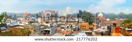 Panorama of the ancient Agra city. The famous mausoleum Taj Mahal in the background - stock photo