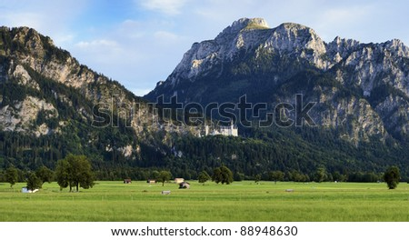 Panorama of the Bavarian Alps with Neuschwanstein Castle, Germany - stock photo