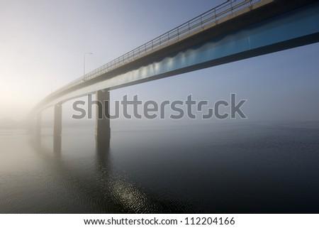 Panorama of the bridge with fog - stock photo