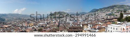 Panorama of the capital of Quito during the day with the Panecillo and the old colonial section of the city. Quito was the first UNESCO Heritage site in the world. - stock photo