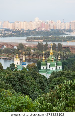 Panorama of the city Kiev. Ukraine. Monastery Vydubitsky. The Dnieper River and new buildings in Kiev - stock photo