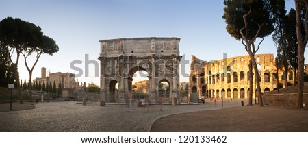 Panorama of the Colosseum and Arch of Constantine at sunset, Rome, Italy - stock photo