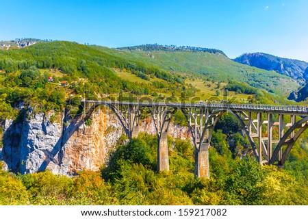 Panorama of the Durdevica Tara Bridge on Tara River, a concrete arch bridge over the Tara River in northern Montenegro - stock photo