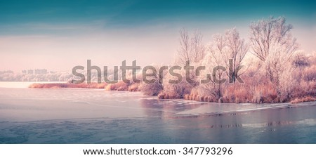 Panorama of the frozen pond in the city park. Instagram toning. - stock photo
