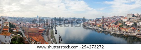 Panorama of the historical Ribeira District and Douro River in the city of Porto, as well the Vila Nova de Gaia Port Wine Cellars and Rabelo Boats in Portugal during sunset. Unesco World Heritage Site - stock photo