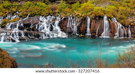 Panorama of the Hraunfossar falls in Iceland - stock photo