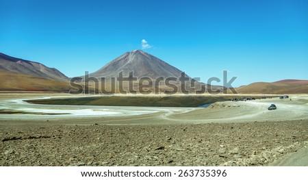 Panorama of the Laguna Verde is a salt lake at the foot of the volcanos Licancabur and Juriques - Eduardo Avaroa Andean Fauna National Reserve, Bolivia - stock photo
