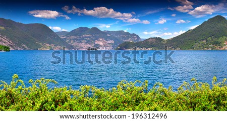 Panorama of the Lake Iseo, a bright sunny day. Italy, the Alps,. - stock photo