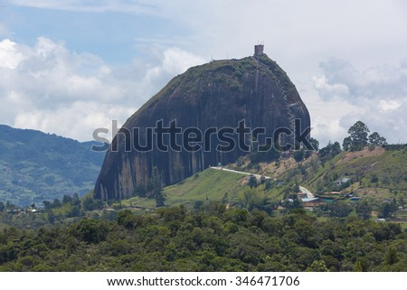 Panorama of the lakes and islands in Guatape with the Piedra el Penol with blue cloudy sky, near Medellin, Colombia. - stock photo