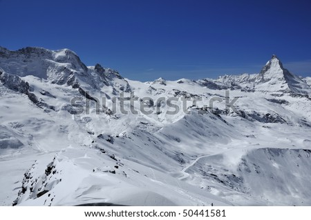 Panorama of the Matterhorn, Breithorn and the Gornergrat railway station and observatory in the Swiss Alps over Zermatt