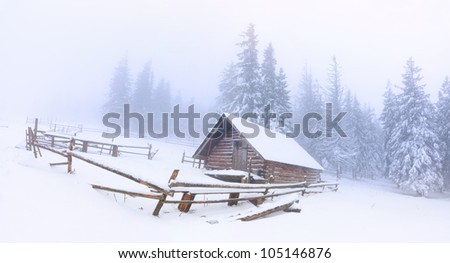 panorama of the old farm in the mountains at winter - stock photo