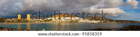 panorama of the resort town of Las Americas oceanfront Canary Islands in sunset light - stock photo