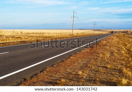 Panorama of the road to steppes - stock photo